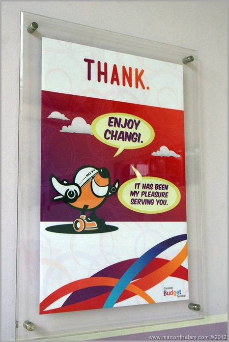 Singapore Changi Airport -- Greet, Smile, Thank program sign -- thank with plane logo