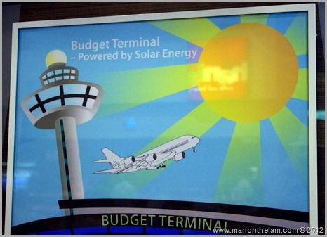 Singapore Changi budget airport powered by solar energy sign