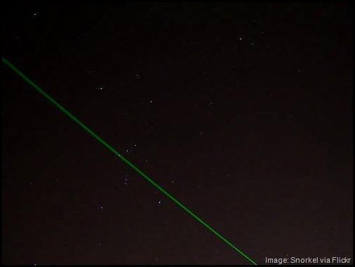 Laser in night sky