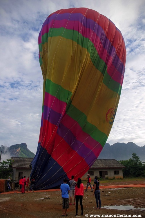 Hot-air-balloon-being-deflated-Vang-Vieng-Laos.jpg
