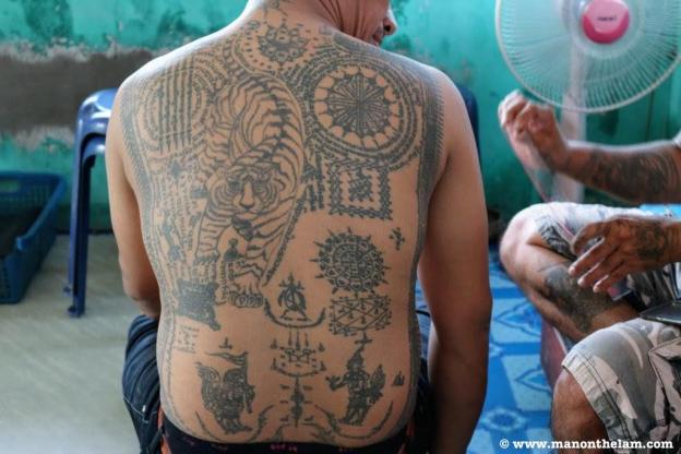 Sak Yant Tattoos on Thai Man -- Where Sidewalks End Ayutthaya Thailand.JPG