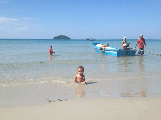 Family at beach in asia