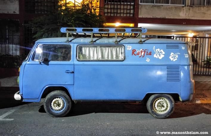 Vintage blue retro Volkswagen VW campervan at night