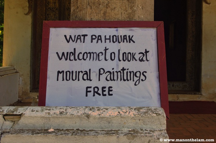 Wat Pa Houak welcome to look at mural paintings free sign Luang Prabang Laos