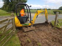 Digging out a bell mouth access into a field 3