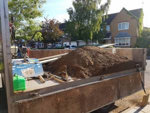 Rotovating leveling 1 and a half tons of good soil preparing to Turf front garden Burnham on Crouch 2