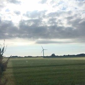 Typical Danish scene of flat countryside and sustainable energy