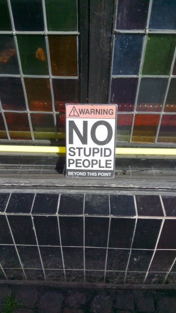 A polite notice to customers outside a bar