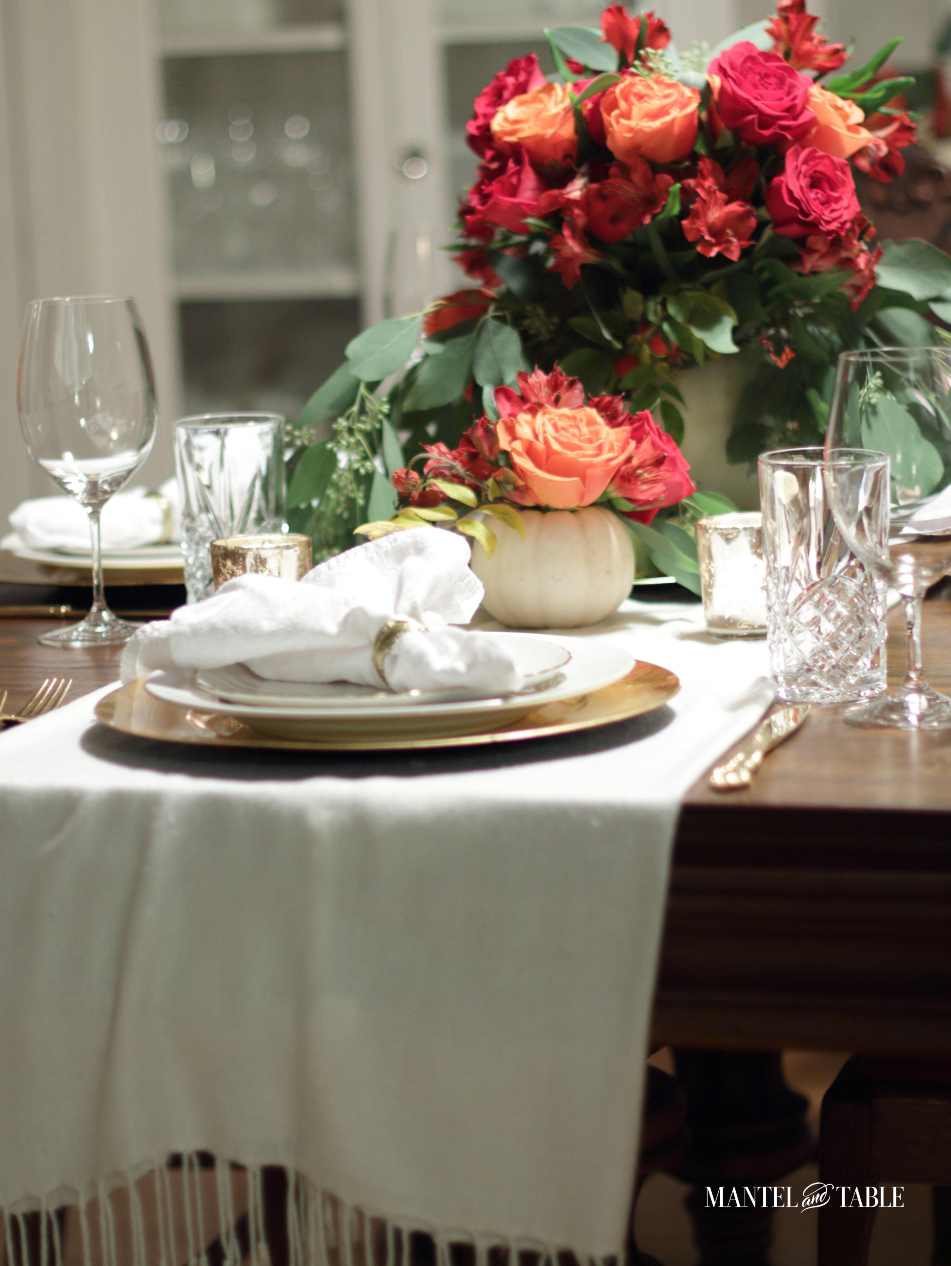White pumpkin flower arrangement centerpieces on the table
