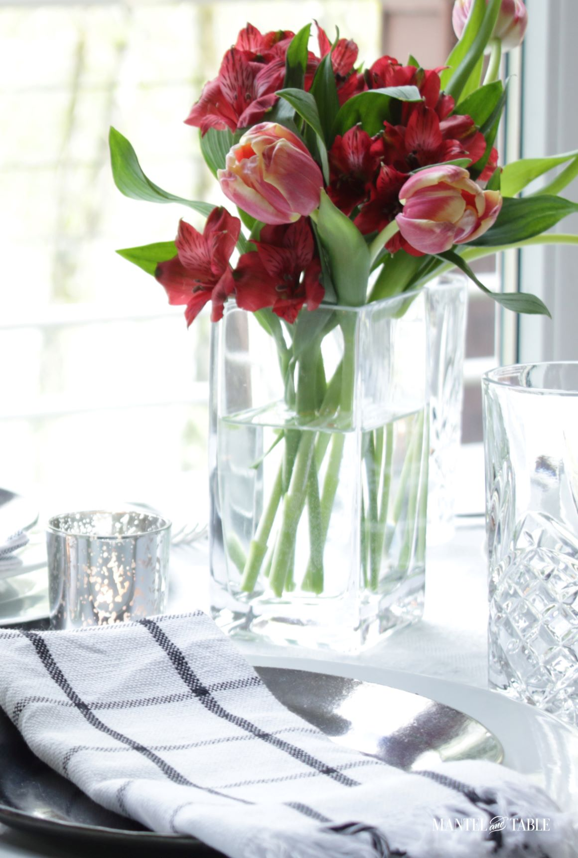 Elegant Spring Picnic tablescape closeup of flower arrangement