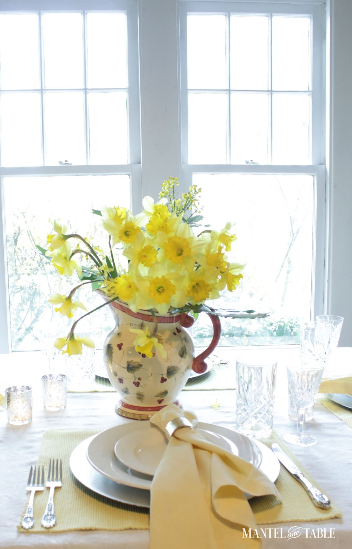 View out the window across daffodil table setting
