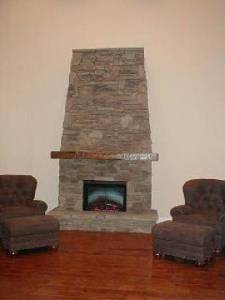 Wyatt Family Mantel #1003 Country is Hand-Hewn and is shown in Oak wood.