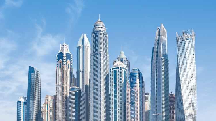 concrete high rise buildings under blue sky