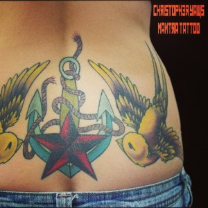 Lower back tattoo by Chris Yaws