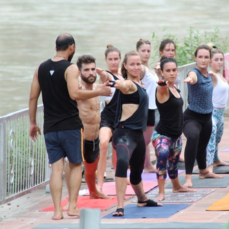 Mantra Yoga Meditation Students Practicing Yoga nearby Ganges