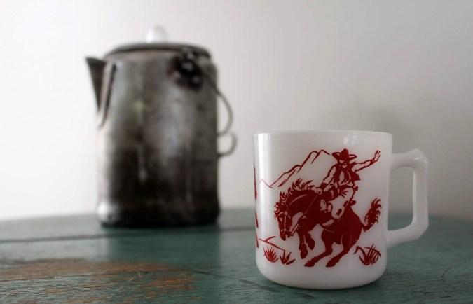 How to brew cowboy coffee- A cowboy coffee mug and kettle