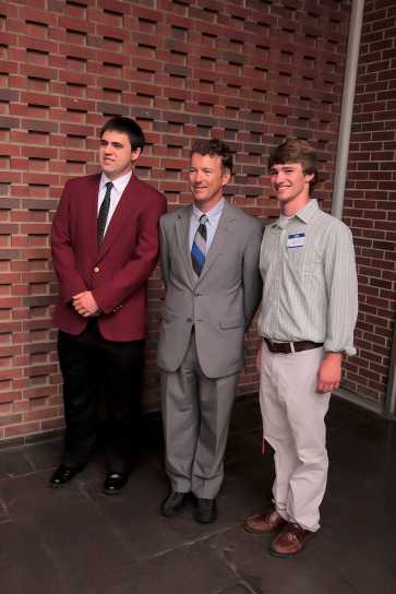 Elliott Fowler (12) and his brother stand with Rand Paul for a photo.