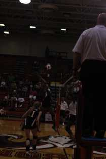 Outside hitter, China Daal, hits the ball.