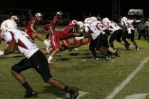 Players attempt to stop opposing linemen from advancing. Photo by Olivia Word