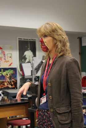 Mrs. McKim reveals her gruesome zipper costume to her physics class during Costume Day. Photo by Kelsi White