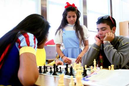 Students pass time by playing chess during Costume Day for Red/White Week. Photo by Jackie Leachman