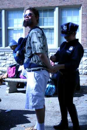 Elizabeth Wiseman (12) dressed as a LMPD for Costume Day for Red/White week arrests a student during lunch. Photo by Jackie Leachman