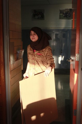 Maha Jabbar (12) walks into Ms. Alesia William's (English) room after deciding that the hallway was not a good place to have a meeting.
