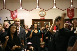 """Students join Mr. Kuhn in singing """"All My Life I Wanted to Kill a Bulldog"""" towards the end of the funeral. Photo by Alexis Weaver"""