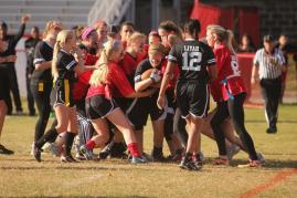 Kristin Mudd (12) is swarmed by Junior players, such as Lauren Fiscus (11) and Kelsey Carrier (11).