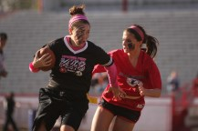 Morgan Allen (12) tries to run past Emily Wilbar (11).