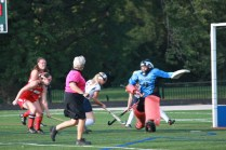 Clare Grady (12) tries to get the ball away from Sacred Heart.