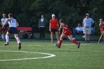 Renee DuFour (11) runs with the ball towards Sacred Heart's goal.