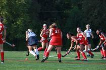 Clare Grady (12) runs into a crowd of players to take the ball away from Sacred Heart.