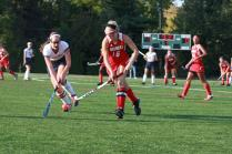 Hannah Kingsbury (12) fights to keep the ball away from an opposing player.
