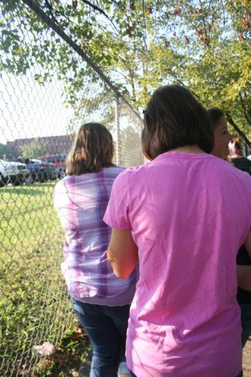 Rachel Chance (11) and other students walk along the side walk after the fire alam rang. Photo by Miracle Stewart