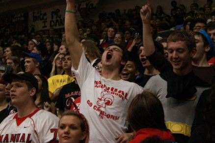 Ben Flannigan (11) screams and fist pumps during the pep rally. Photo by Meg Shanks