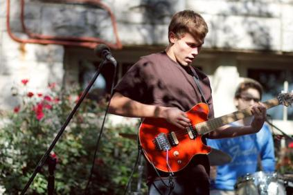 Cole McNair (12) plays electric guitar with his band as the first act at Ramstock.