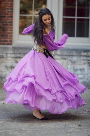 Sarah Slayton (11) glides across the courtyard in her belly dancer costume post Ramstock.