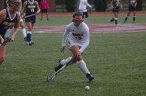 Renee DuFour (11, #15) dribbles the ball up the field. Photo by Kinsey Ball