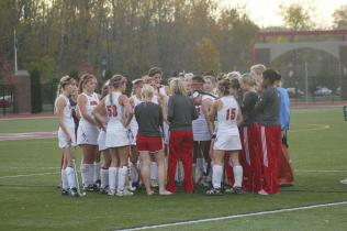 The field hockey team recieves a pep talk during a time out. Photo by Kinsey Ball