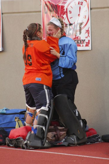 Assumption goalie comforts Amber Kleitz (12, #00) after a tough loss to Sacred Heart. Photo by Kinsey Ball