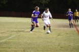 Emily Wilbar (11) dribbles around a Male player headed up the field to score.