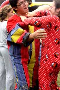 Niko Palania (11) talks off his velcro suit after being on the velcro wall. Photo by Shantel Pettway