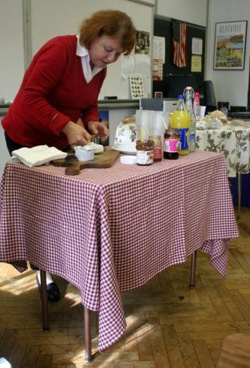 Madame Farman (French) prepares condiments for students' bread