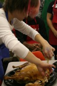 Elena Zuber (12) helps to carve the turkey. Photo by Alexis Weaver