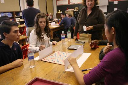 Ms. Denee Walsh (French) reiterates the rules for the junior varsity French Scrabble players. Photo by Mai Nguyen.