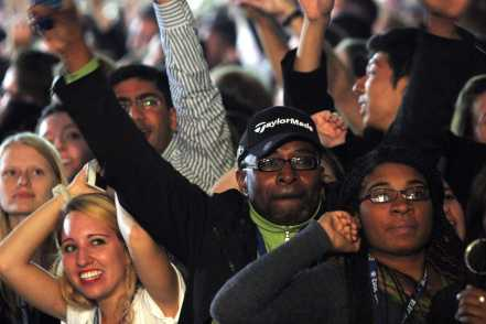 Obama suppoters cheer as Obama wins another state.