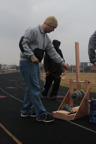 George Dailey (11) finished assembling his catapult before putting it to use on the practice field.