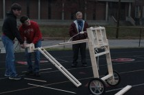 Jonathan Fairfax (12) and Mitchell Becker (12) prepare to test out their catapult.