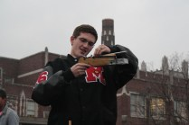 Corbin Mosser (12) gets ready to test out his homemade weapon against a make-shift target on the practice field.